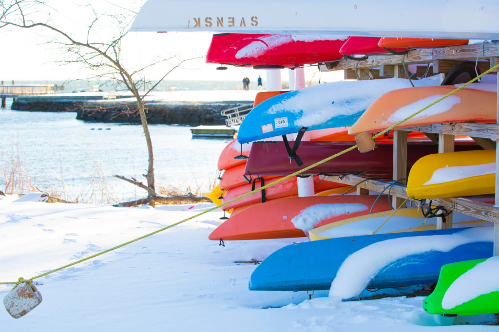 Kayaks covered in snow in Southport Connecticut at Ye Old Yacht Yard