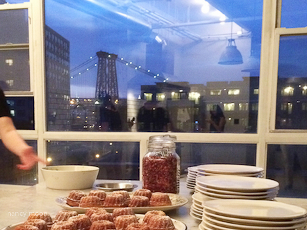 Dessert is put out. See the bridge in background.