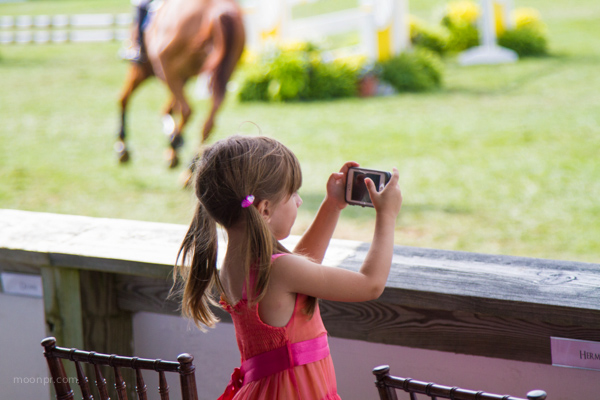 This is absolutely one of my favorite photos. A little shutterbug at the Hampon Classic Horse Show.