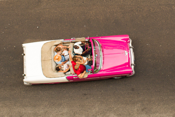 Pink convertible from our balcony.