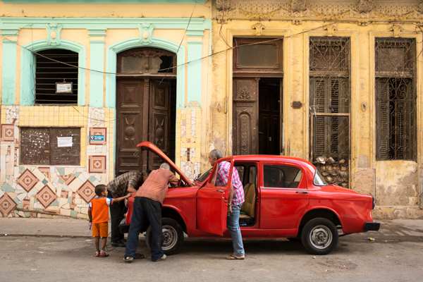 Orange car and family Regala Havana Cuba