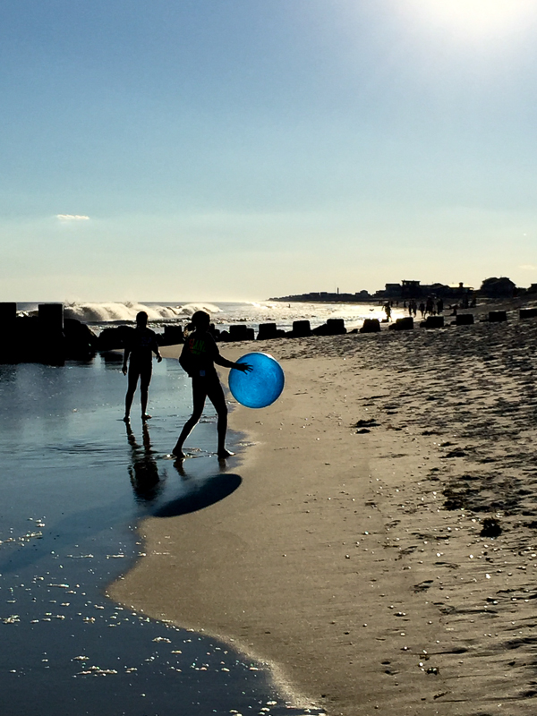 Blue beach ball in the sunset
