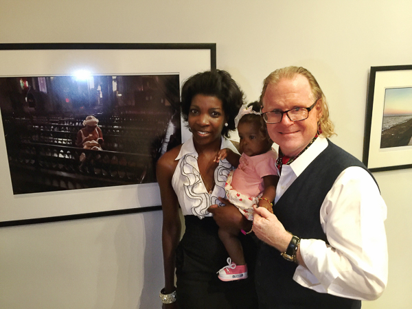 Liliany Rodriguez Mola, her baby Lia Tenay Diaz Rodriguez with photographer Peter Turnley.