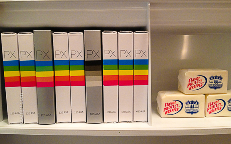 Our fridge with polaroid film ... right next to the butter