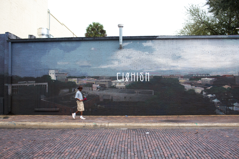Miami street artist Axel Void painted a postcard view of downtown {Gainesville, Florida}